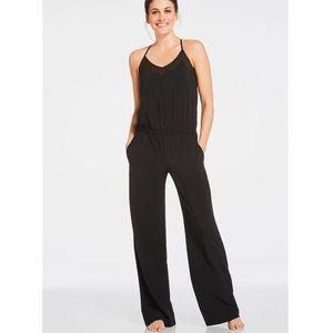 ef7944a0518 Fabletics Pants - Fabletics Dash Jumpsuit in Black Womens Size M 8
